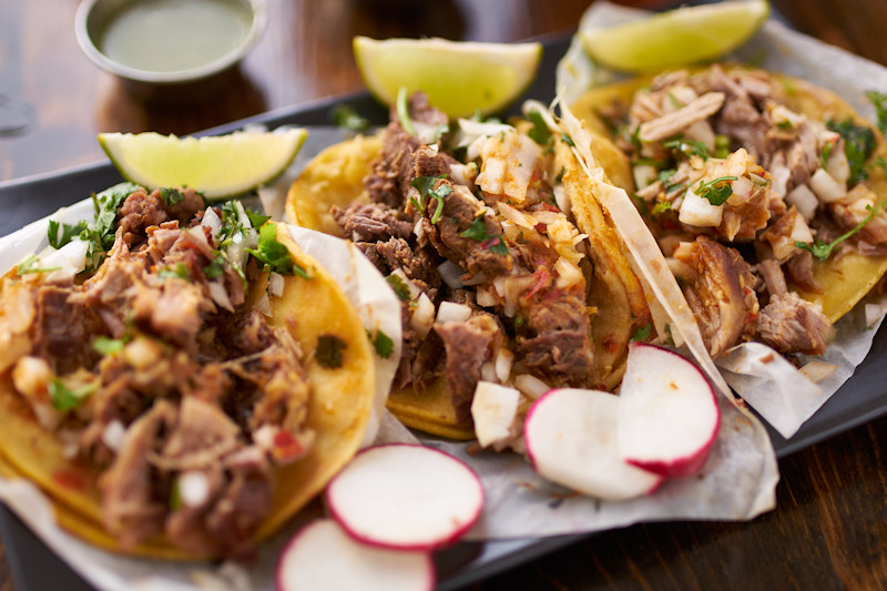 Street tacos with lime and radishes