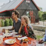 Couple dining outdoors at Barn8