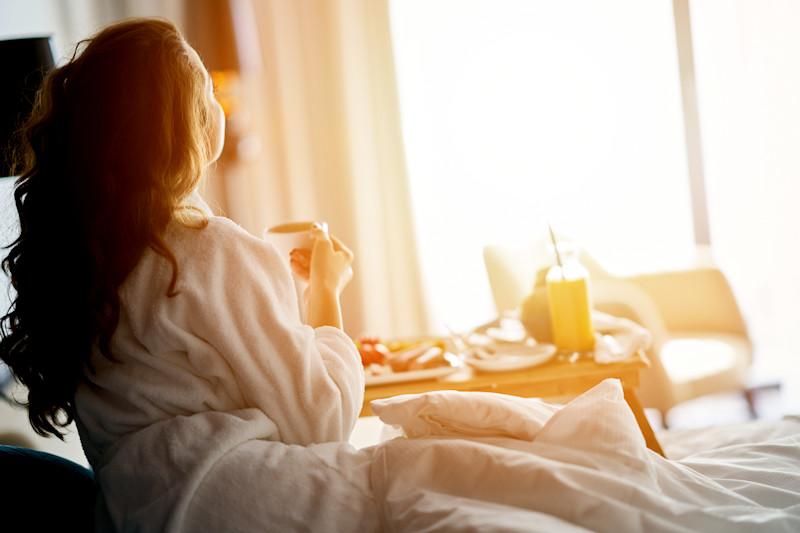 Woman enjoying her Bed & Breakfast cozy room