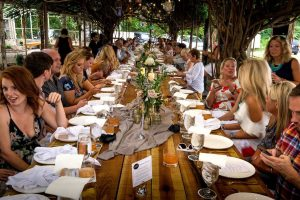 A Group of people dining at 3rd Turn at a communal table during event