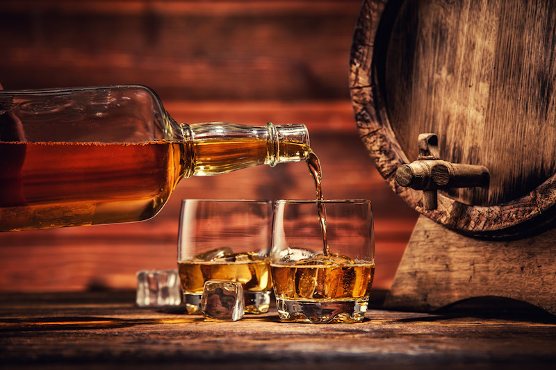 Pouring a glass of bourbon