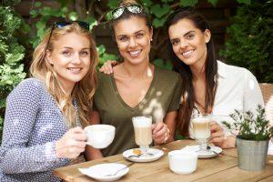 Group of girlfriends enjoying coffee