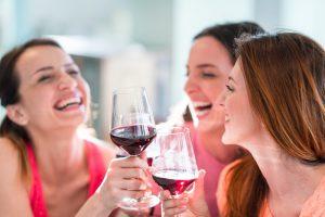 Group of girlfriends enjoying a glass of wine