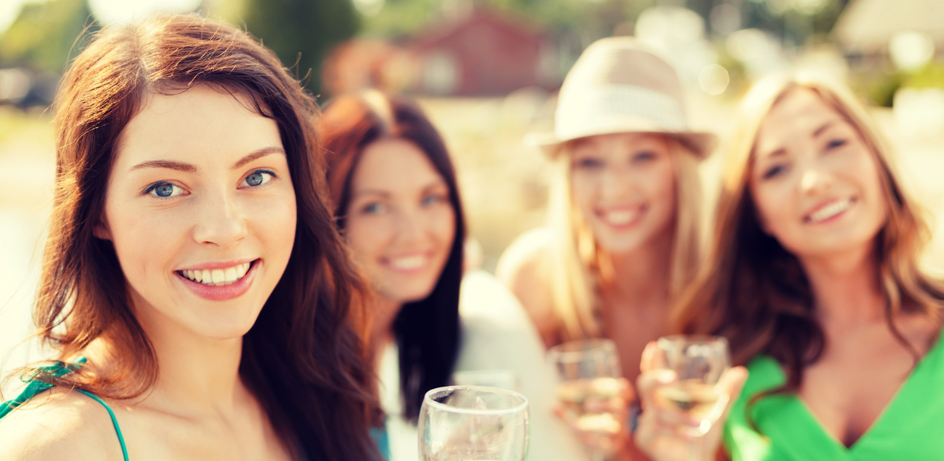 Group of girlfriends having fun and drinking wine