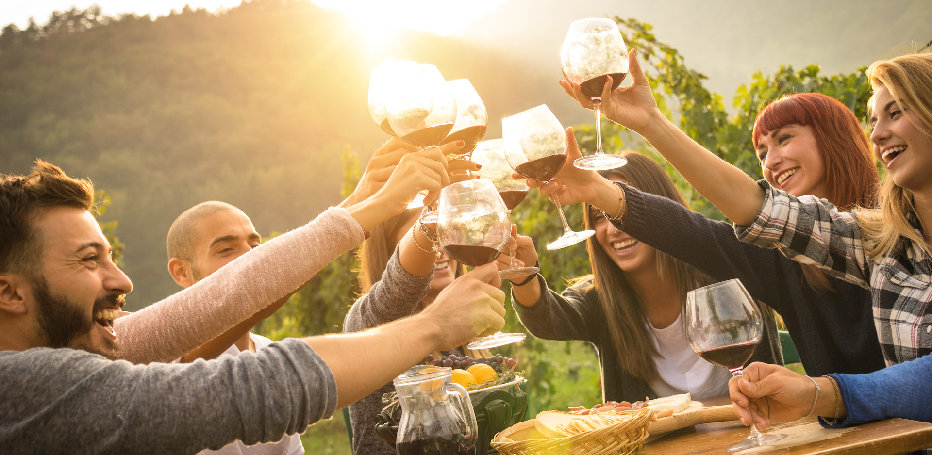 Group of friends enjoying a wine tasting at a winery
